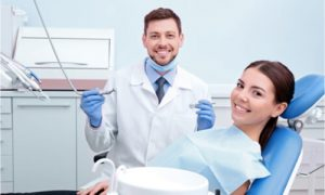 The dentist is ready to treat the patient's teeth.