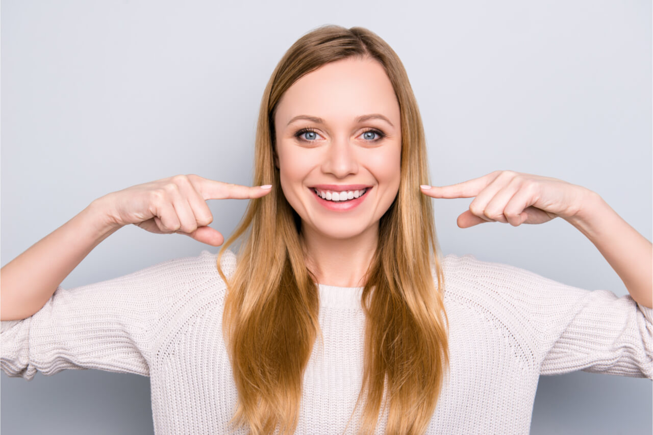 The woman has healthy gums.
