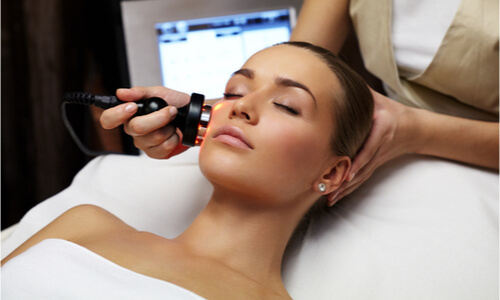 woman getting pampered using a facial enhancement procedure